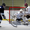 Newburyport: Newburyport goalie Anthony Frederico readies for a shot by Triton's Nate Williamson which missed the net. Bryan Eaton/Staff Photo