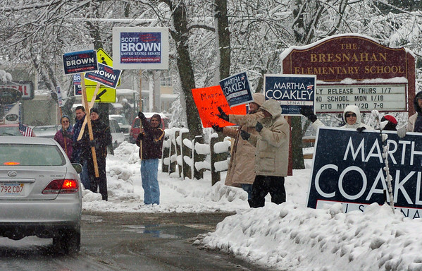 Newburyport: Despite the falling snow, a good number of Martha Coakley and Scott Brown supporters stood with their signs outside the voting station at the Bresnahan School in Newburyport early yesterday afternoon. Bryan Eaton/Staff Photo