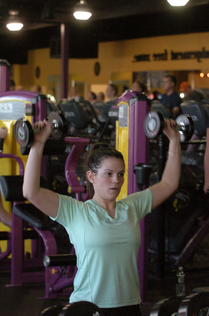 Newburyport: Lindsay Muise of Newburyport works with dumbbells while doing lunges at Planet Fitness. Bryan Eaton/Staff Photo