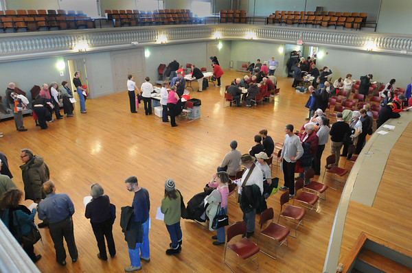 Newburyport: People lining up for an H1N1 flu shot circled aroung the auditorium at Newburyport City Hall with the line  extending downstairs to the lobby yesterday morning. Bryan Eaton/Staff Photo