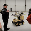 Boston: Trooper Timothy Murray of the Massachusetts State Police Bomb Squad gives a demonstration of a protype robot to the media. Bryan Eaton/Staff Photo