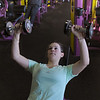Newburyport: Lindsay Muise of Newburyport works with dumbbells on an incline at Planet Fitness. Bryan Eaton/Staff Photo
