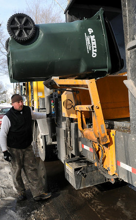 Newburyport: Dennis Dupont of Integrated Paper Recycling in North Andover loads recyclables on Curzon Mill Road in Newburyport. Bryan Eaton/Staff Photo