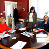Newburyport: Newburyport Mayor Donna Holaday and city hall staffers joke for a second before getting serious in one of several meetings the mayor has held this week. From left, Bill Squillace, city auditor;  Lois Honegger, mayoral executive aide; Holaday; Cheryl Robertson, treasurer and Julia Godtfredsen, director of policy and administration. Bryan Eaton/Staff Photo