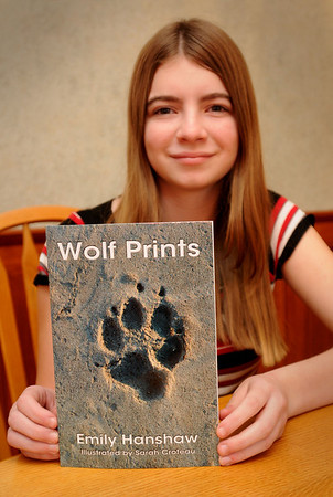 Amesbury:  Emily Hanshaw, 14, wrote a book about a family of wolves living in Alaska. The Amesbury freshman is working on book number two of the three part series. Bryan Eaton/Staff Photo