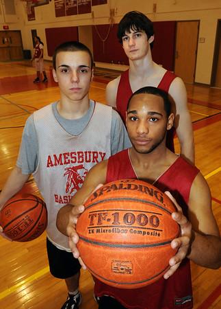 Amesbury: Amesbury basketball underclassmen having a good season, clockwise from front, Stephan Deas, Matt Talbot and Tyler Lay. Bryan Eaton/Staff Photo