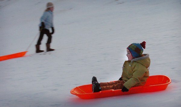 Newburyport: Damien Lamb, 3, of Newburyport gets some sledding in yesterday afternoon. The Newburyport youngster was at March's Hill with his father, Dan. Bryan Eaton/Staff Photo