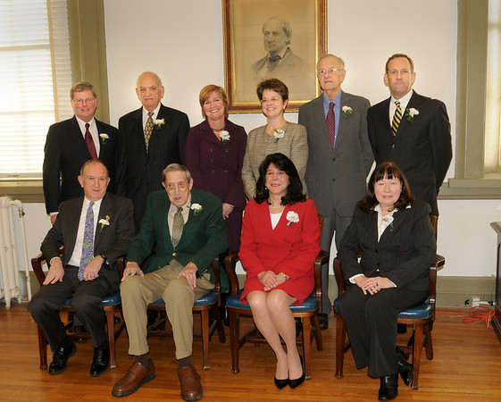 Newburyport: Under a portrait of Newburyport's first mayor, Caleb Cushing, the nine living former mayors attended the inauguration of Mayor Donna Holaday.  Back, from left, John Moak, Byron Matthews, Mary Anne Clancy, Lisa Mead, Richard Sullivan and his son, Chris. Front, from left, Al Lavender, George Lawler, Holaday and Mary Carrier. Bryan Eaton/Staff Photo