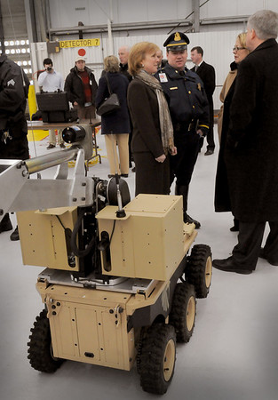 Boston: State police Lt. Steve Hines and his wife, Susan, left talk with Congressman Nikki Tsongas and Brian Hart, president of Black-I Robotics which built the prototype robot in foreground. The robot, to be used the state police bomb squad at Logan Airport, is being dedicated to their son, US Army 1st Lt. Derek Hines who was killed in action in Afghanistan. Bryan Eaton/Staff Photo