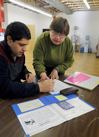 Amesbury: Jane Hinckley works with Ben Younger in math at the Coastal Connections' new location in Amesbury. Bryan Eaton/Staff Photo