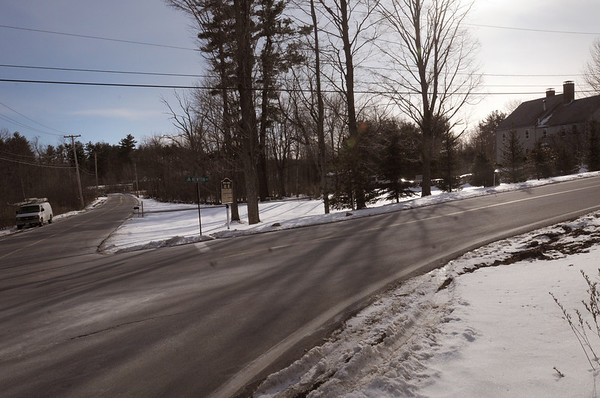 Amesbury: Dallas Haines, who lives in home at right in photo, and other neighbors are asking the town to address flooding problems from the Powow River as it passes under Newton Road just past van parked in left of  photo. Bryan Eaton/Staff Photo