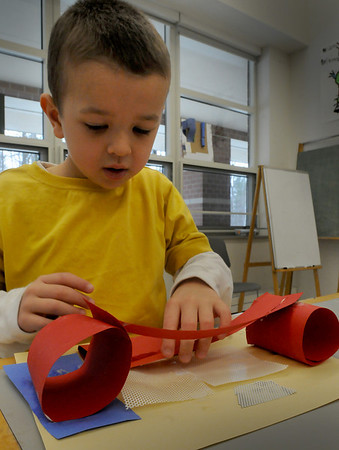 Salisbury: Kindergartner Brian Story, 6, creates a bridge for insects in Shannon O'Brien's art class at Salisbury Elementary School on Thursday morning. The students were shown photos of the works of famous architects and encouraged to be creative using scrap pieces of paper and materials to create their own works. Bryan Eaton/Staff Photo