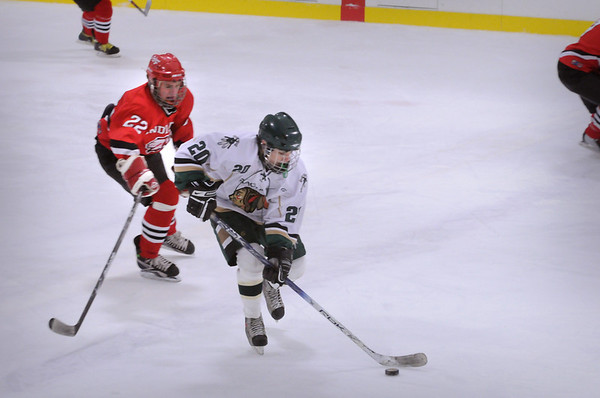 Haverhill: Amesbury player 22 moves in on Pentucket's Will Ingraham Saturday night at the Haverhill Rink. Bryan Eaton/Staff Photo