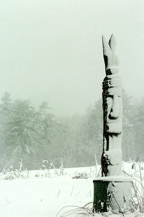 Amesbury: The sticky snow from the past two days has clung to just about everything including the totem pole at the entrance to Battis Farm in Amesbury where the community garden is located. Bryan Eaton/Staff Photo