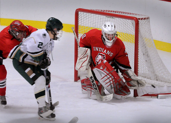 Haverhill: Amesbury goalie Mathew Irwin deflects a shot by Pentucket's Mike Tashjian Saturday night in Haverhill. Bryan Eaton/Staff Photo