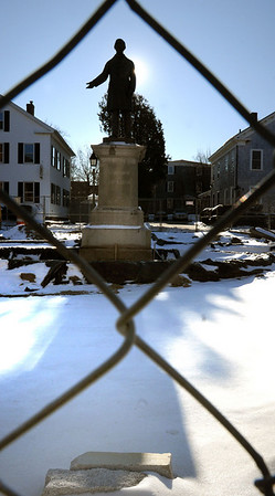 Newburyport: The statue of William Lloyd Garrison reigns over a snowy landscape at Brown Square, which is being renovated. Work is on hold until spring and should be completed in the fall. Bryan Eaton/Staff Photo