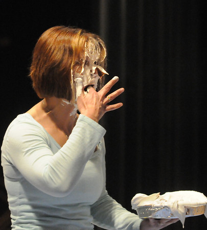 Amesbury: Amesbury Middle School teacher Kathy Randall makes the best of being hit by a pie getting a few tastes of it. Bryan Eaton/Staff Photo