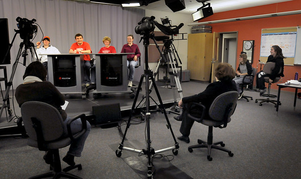 Amesbury: Amesbury High School quiz contestants are tested in rehearsal by Kathy Beaudoin, left, and Margaret Furlong, backs to camera. The six contestants, from left, Tyler Lay, James Pelkey, Patrick Hopkins, Samantha Fortin, Peter Seiss and Lauren Joyce. Bryan Eaton/Staff Photo