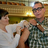 Newburyport: Dean Wills rolled up his sleeve for his H1N1 shot from Kristen Lynch, RN, upstairs at Newburyport City Hall yesterday morning. Bryan Eaton/Staff Photo
