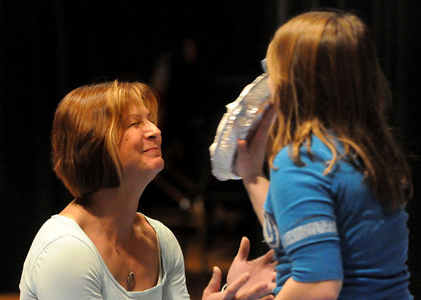 Amesbury: Amesbury Middle School teacher Kathy Randall braces for a whipped cream pie in the face by student Genevieve Deschenes on Friday afternoon. The student was one of several raffle winners chosen to throw the pies as a fundraiser for the school's band. Bryan Eaton/Staff Photo