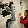 Salisbury: Alex Rodriguez, 13, works on a painting of boxer Muhammad Ali in the art room at the Boys and Girls Club on Tuesday afternoon. The children are creating a mural of different sports legends throughout the year. Bryan Eaton/Staff Photo