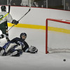 Haverhill: Pentucket's Alex Connolly (12) scored the first goal in the game last night, getting the puck past Triton goalie Carl Orlandi. Bryan Eaton/Staff Photo