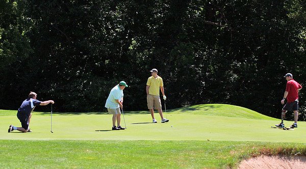 Newbury: A foursome finishes off a hole at the Ould Newbury Country Club Monday morning during the annual Yankee Homecoming golf tournament. Photo by Ben Laing/Staff Photo