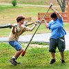 Amesbury: Frank Vanbokkelen, 20, left, and Janessa Demeule, 21, both of Hampton, participate in Dagorhir, a simulated medieval battle using foam rubber weapons, at the Amesbury town park Tuesday. Photo by Ben Laing/Staff Photo