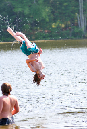 West Newbury: Sean Duval of Haverhill does a back flip into Mill Pond in West Newbury Monday afternoon as he and his friends looked to cool down on the way home from the Newburyport Skate Park. Photo by Ben Laing/Staff Photo