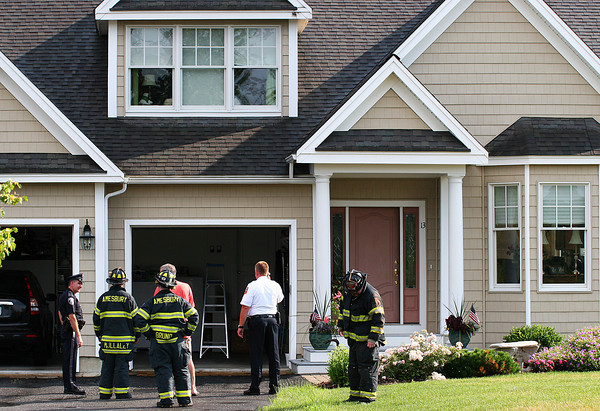 Amesbury: Amesbury firefighters inspect the damage to a home on Riverview Heights that was struck by lightning Monday afternoon. Photo by Ben Laing/Staff Photo