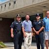 Byfield: Newbury Police Chief Michael Reilly, left, stands with Triton Middle School Principal, Jared Fulgoni, new Student Rescource Officer Stephen May, and Triton High School Principal Kevin McLaughlin, right. Photo by Ben Laing/Staff Photo