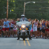 Newburyport: A wave of runners dash from the starting line Tuesday night as the 50th annual Yankee Homecoming Road Race took place at the foot of Newburyport High School. Photo by Ben Laing/Staff Photo