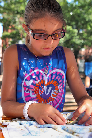 Newburyport: Gabrielle Tringali, 11, of Malden, runs her own craft booth on Inn Street, Gabrielle's Wish Pearls. Gabrielle offers oysters that customers can select for their pearls and create original jewlery with. Photo by Ben Laing/Staff Photo