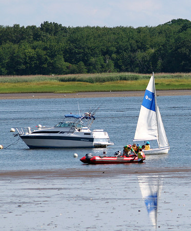 Newburyport: Students from the American Yacht Club's boat camp troll the Merrimack River near Joppa Flats during low tide Thursday morning. Photo by Ben Laing/Staff Photo