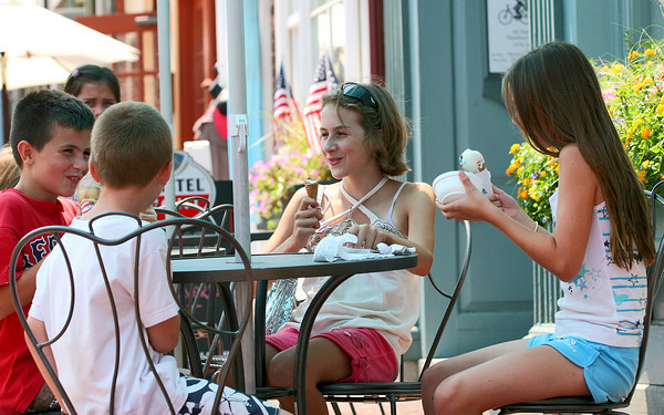 Newburyport: A ice cream from Gramm's on State Street in Newburyport was the perfect answer from the heat for Kylie White, 10, right, Ally Scholtz, 12, Ty Schotz, 12, and Connor White, 8, front left. Photo by Ben Laing/Staff Photo