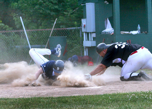 Amesbury: Newburyport Nationals' catcher, Burnham (33) tags a runner out at home plate during Wednesday nights game against Lynn. Photo by Ben Laing/Staff Photo