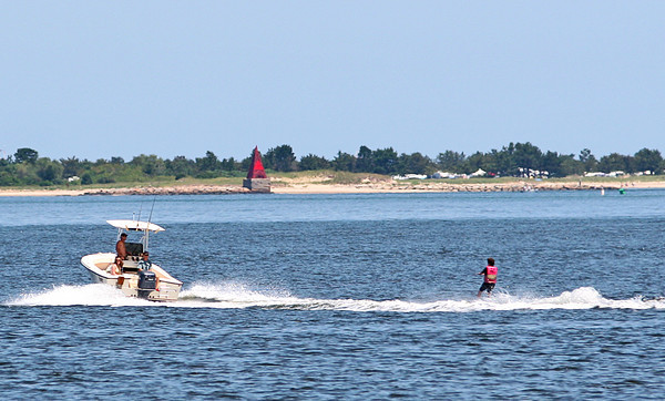 Newbury: A boat tows a waterskier around the Merrimack River off of Plum Island Turnpike Thursday afternoon. Boating traffic was relatively calm despite the gorgeous weather. Photo by Ben Laing/Staff Photo