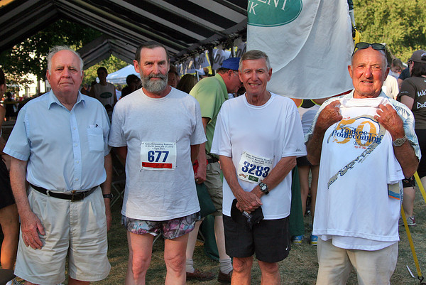 Newburyport: Four of the original runners from the first Yankee Homecoming road race in 1960, from left, Royce Saywer, Carlton Comstock, Ryan Buckley, and Gerry Grasso. All four were honored prior to the running of this year's race on Tuesday. Photo by Ben Laing/Staff Photo
