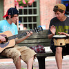 Newburyport: Jordan Dunn-Pilz, 15, strums the guitar while accompanied on drums by Clayton Vye, 15, Tuesday afternoon in Market Square in Newburyport. Photo by Ben Laing/Staff Photo