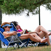 Newburyport: Amanda Terzin, left, and Rosemary Diisso, right, both of Reading, were among dozens set up along the boardwalk with their lawn chairs Tuesday, enjoying the weather. Photo by Ben Laing/Staff Photo