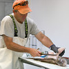 Seabrook: Eddie Eastman of Eastman's Fish Market in Seabrook, fillets a fish. Photo by Ben Laing/Staff Photo