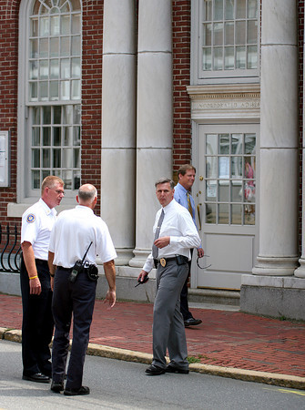 Amesbury: Police and fire officials stand outside the entrance to the Provident Bank on Market Street in Amesbury Monday morning, after a bomb threat force the evacuation of the building. Photo by Ben Laing/Staff Photo