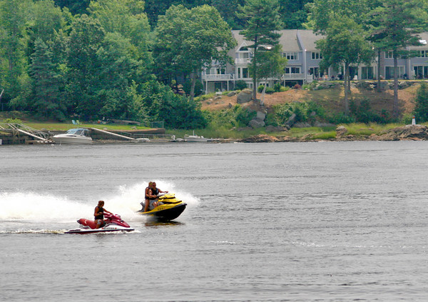 Amesbury: A pair of jetskis race around the Merrimack River off of Point Shore in Amesbury Monday morning. Photo by Ben Laing/Staff Photo