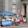 Newburyport: J.P. Arslanian, owner of Plum Island Lobster Co., sets up his stand outside the Custom House in downtown Newburyport. Arslanian is one of three vendors with a city license to operate downtown. Photo by Ben Laing/Staff Photo