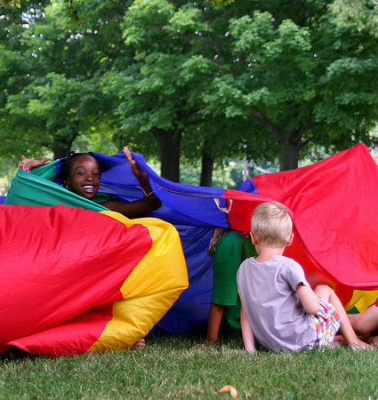 Newburyport: Campers at the YWCA School's Out program play Alligator Hunter with a parachute at the Bartlett Mall in Newburyport Monday morning. Photo by Ben Laing/Staff Photo
