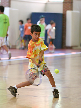 Newburyport: Kabir Reddy, 7, of Newburyport, lines up a volley during Tuesday morning's Newburyport Youth Services summer tennis program. The program was moved into the gym at the high school due to the heat. Photo by Ben Laing/Staff Photo