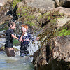 Newbury: Liam Murray, left, and Casey Holmes, right, play in the water along the rocks at Plum Island center Monday afternoon. The pair were at the beach with their mom's enjoying the beautiful weather. Photo by Ben Laing/Staff Photo