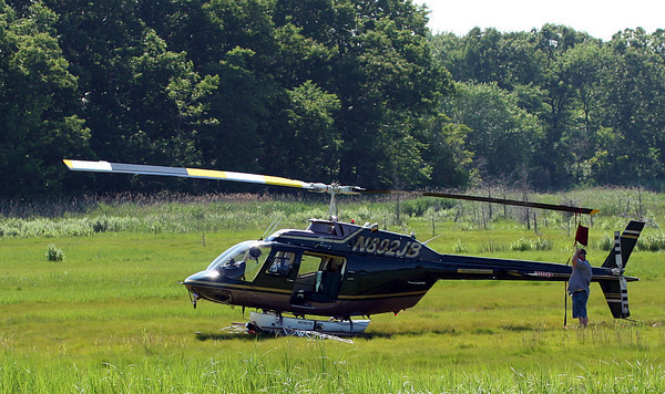 Newbury: A helicopter, spraying for mosquitos, was forced to make an emergency landing in the marsh near the Newbury/Rowley line Thursday afternoon, after suffering from a mechanical failure. Photo by Ben Laing/Staff Photo
