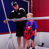Newburyport: Eddie Hill adjusts the bar of the endless hockey treadmill for Colin Richmond, 7, of Newburyport. Bryan Eaton/Staff Photo