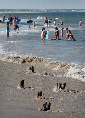 Salisbury: Pilings from the old Frolics popping through the sand at Salisbury Beach, here at low tide, have some concerned about ithe possibility of injury. Bryan Eaton/Staff Photo